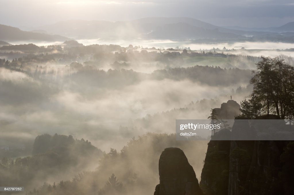 Bastei area with Mönch (Mönchstein) rock pinnacle in early morning fog, Saxon Switzerland National Park, Saxony, Germany, Europe : Stock Photo