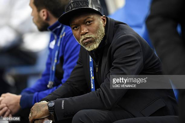 Bastia French forward Djibril Cisse watches play on April 11 2015 during a French League Cup final football match Bastia vs Paris SaintGermain at the...
