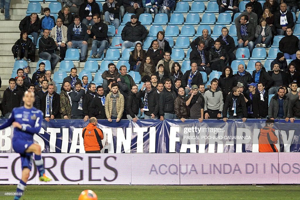Bastia supporters unfolded a banner reading 'Bastia anti fair-play' during the French L1 football match Bastia (SCB) against Monaco in the Armand Cesari stadium in Bastia, Corsica, on February 15 , 2014. Monaco defeated Bastia 2-0. AFP PHOTO / PASCAL POCHARD-CASABIANCA