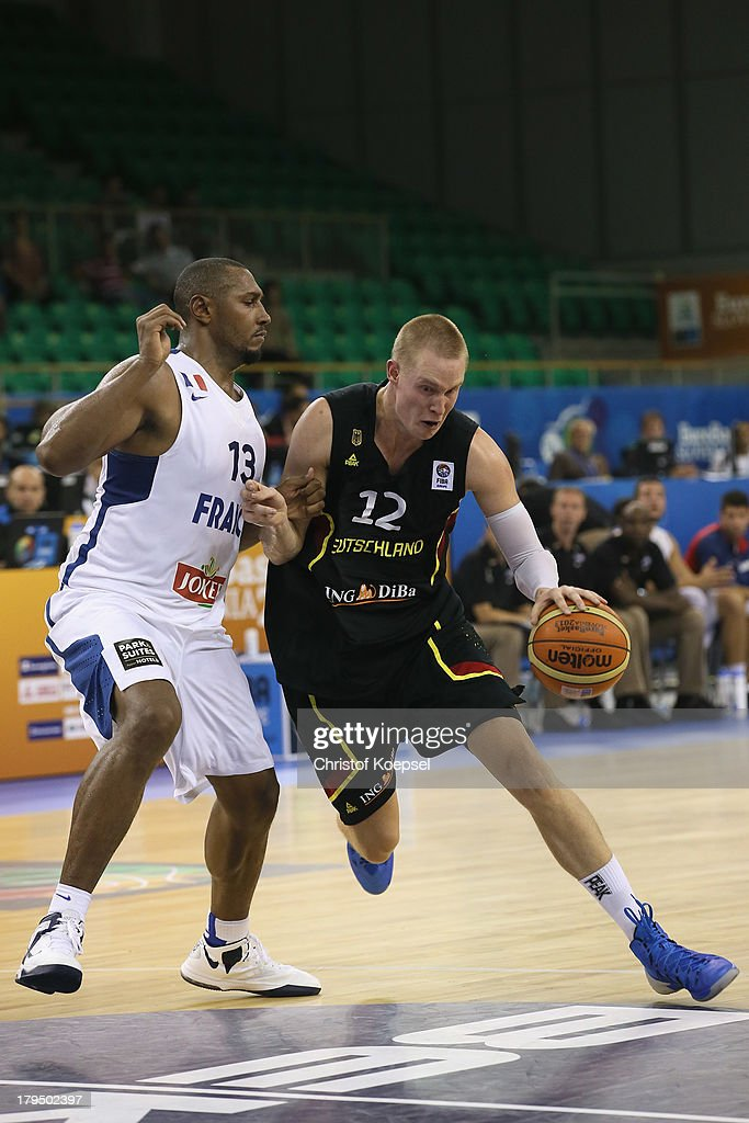 Bastian Doreth of Gemany defends against Robin Benzing of Gemany during the FIBA European Championships 2013 first round group A match between France and Germany at Tivoli Arena on September 4, 2013 in Ljubljana, Slovenia.