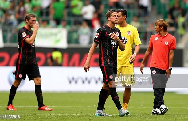 Bastian Oczipka of Eintracht Frankfurt and his team mates are looking dejected after loosing the Bundesliga match between VfL Wolfsburg and Eintracht...