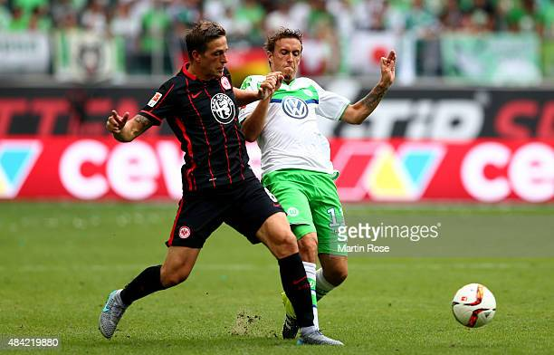 Bastian Oczipka of Eintracht Frankfurt challenges Max Kruse of VfL Wolfsburg during the Bundesliga match between VfL Wolfsburg and Eintracht...
