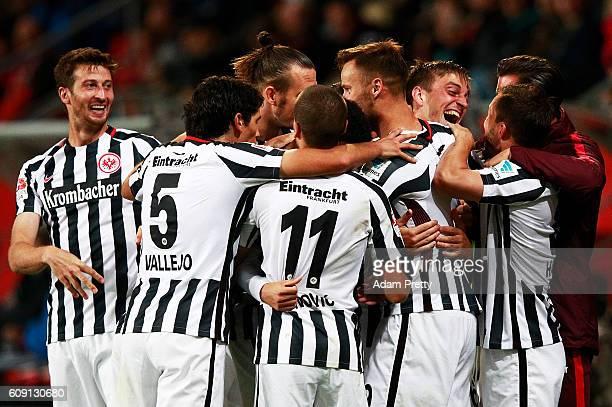 Bastian Oczipka of Eintracht Frankfurt is congratulated after scoring the second goal during the Bundesliga match between FC Ingolstadt 04 and...