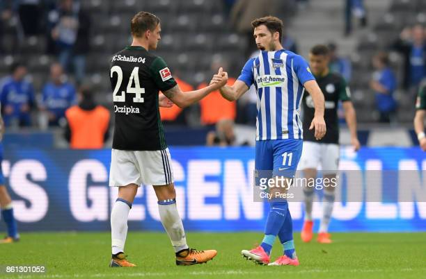 Bastian Oczipka of FC Schalke 04 and Mathew Leckie of Hertha BSC after the game between Hertha BSC and Schalke 04 on october 14 2017 in Berlin Germany