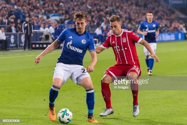 Bastian Oczipka of FC Schalke 04 Joshua Kimmich of FC Bayern Munich during the Bundesliga match between Schalke 04 and Bayern Munich on September 19...