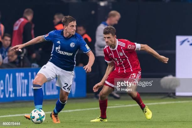 Bastian Oczipka of FC Schalke 04 Thomas Muller of FC Bayern Munich during the Bundesliga match between Schalke 04 and Bayern Munich on September 19...