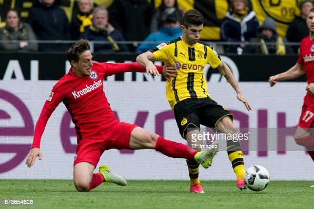 Bastian Oczipka of Frankfurt and Christian Pulisic of Dortmund controls the ball during the Bundesliga match between Borussia Dortmund and Eintracht...