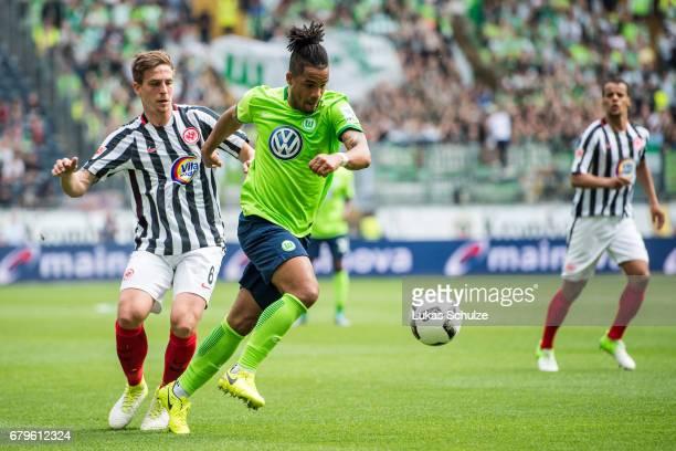 Bastian Oczipka of Frankfurt and Daniel Didavi of Wolfsburg fight for the ball during the Bundesliga match between Eintracht Frankfurt and VfL...