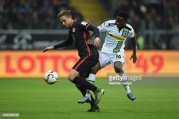 Bastian Oczipka of Frankfurt and Ibrahim Traore of Gladbach compete for the ball during the Bundesliga match between Eintracht Frankfurt and Borussia...