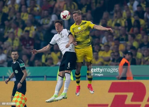 Bastian Oczipka of Frankfurt and Lukasz Piszczek of Dortmund battle for the ball during the DFB Cup final match between Eintracht Frankfurt and...