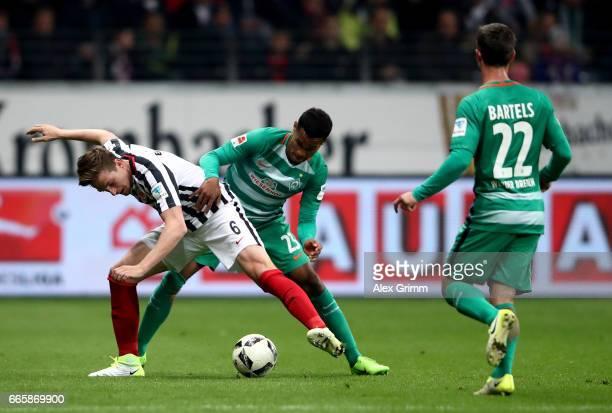Bastian Oczipka of Frankfurt and Theodor Gebre Selassie of Bremen battle for the ball during the Bundesliga match between Eintracht Frankfurt and...