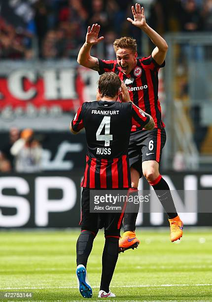 Bastian Oczipka of Frankfurt celebrates her team's first goal with team mate Marco Russ during the Bundesliga match between Eintracht Frankfurt and...