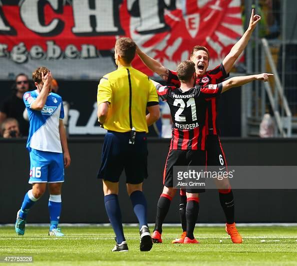 Bastian Oczipka of Frankfurt celebrates her team's first goal with team mate Marc Stendera during the Bundesliga match between Eintracht Frankfurt...