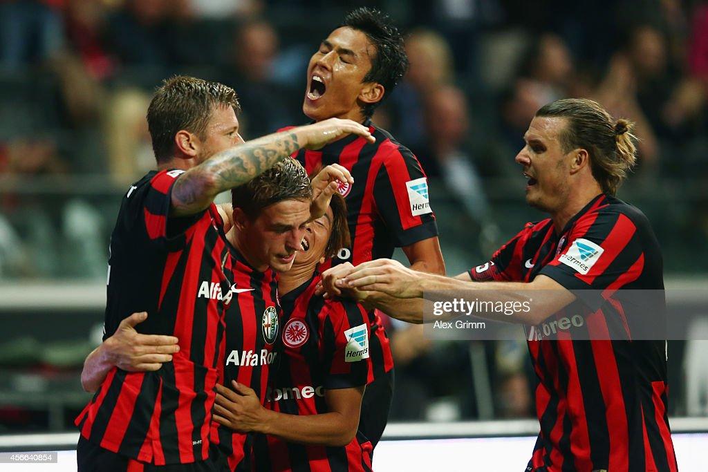 Bastian Oczipka of Frankfurt celebrates his team's third goal with team mates Marco Russ Takashi Inui Makoto Hasebe and Alexander Meier during the...