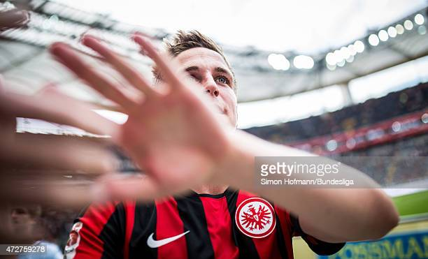 Bastian Oczipka of Frankfurt celebrates winning with supporters after the Bundesliga match between Eintracht Frankfurt and 1899 Hoffenheim at...