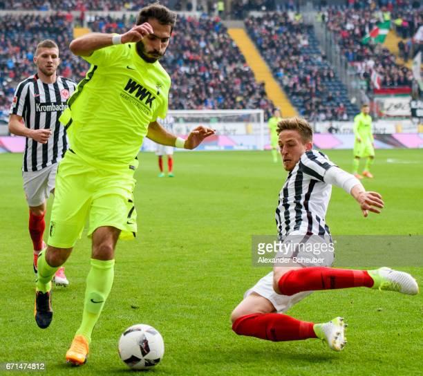 Bastian Oczipka of Frankfurt challenges Halil Altintop of Augsburg during the Bundesliga match between Eintracht Frankfurt and FC Augsburg at...