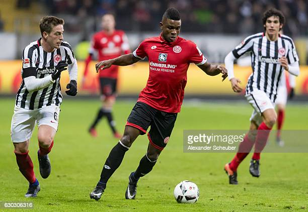 Bastian Oczipka of Frankfurt challenges Jhon Cordoba of Mainz 05 during the Bundesliga match between Eintracht Frankfurt and 1 FSV Mainz 05 at...