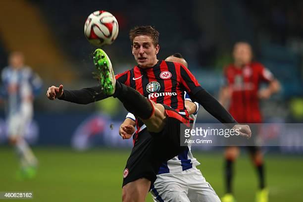 Bastian Oczipka of Frankfurt clears the ball during the Bundesliga match between Eintracht Frankfurt and Hertha BSC at CommerzbankArena on December...