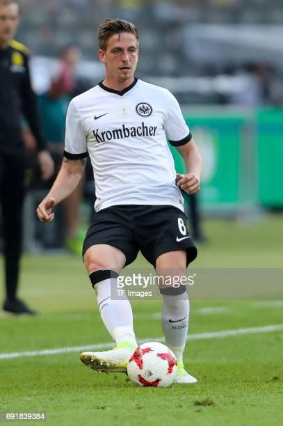 Bastian Oczipka of Frankfurt controls the ball during the DFB Cup final match between Eintracht Frankfurt and Borussia Dortmund at Olympiastadion on...