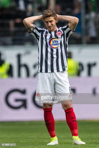 Bastian Oczipka of Frankfurt reacts after loosing the Bundesliga match between Eintracht Frankfurt and VfL Wolfsburg at CommerzbankArena on May 6...
