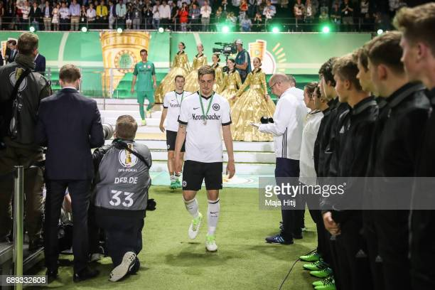 Bastian Oczipka of Frankfurt reacts during the medal ceremony after the DFB Cup final match between Eintracht Frankfurt and Borussia Dortmund at...