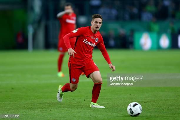 Bastian Oczipka of Frankfurt runs with the ball during the DFB Cup semi final match between Borussia Moenchengladbach and Eintracht Frankfurt at...