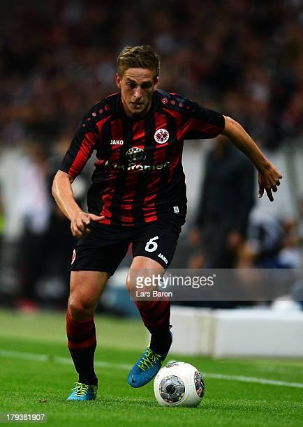 Bastian Oczipka of Frankfurt runs with the ball during the UEFA Europa League playoff second leg between Eintracht Frankfurt and Qarabag FK at...