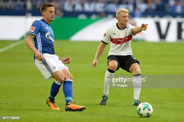 Bastian Oczipka of Schalke and Andreas Beck of Stuttgart battle for the ball during the Bundesliga match between FC Schalke 04 and VfB Stuttgart at...
