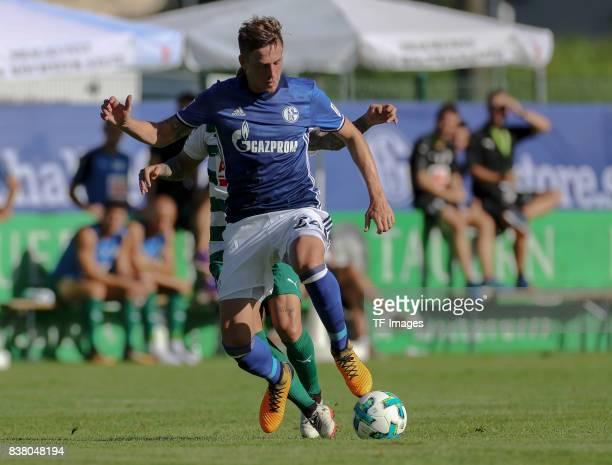 Bastian Oczipka of Schalke and Pena of Eibar battle for the ball during the preseason friendly match between FC Schalke 04 and SD Eibar on July 30...