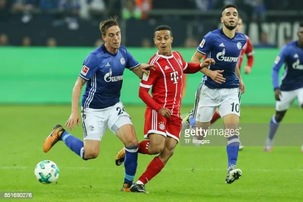 Bastian Oczipka of Schalke and Thiago Alcantara of Bayern Muenchen battle for the ball during the Bundesliga match between FC Schalke 04 and FC...