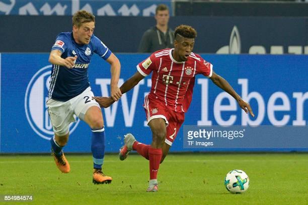 Bastian Oczipka of Schalke Kingsley Coman of Muenchen battle for the ball during the Bundesliga match between FC Schalke 04 and FC Bayern Muenchen at...