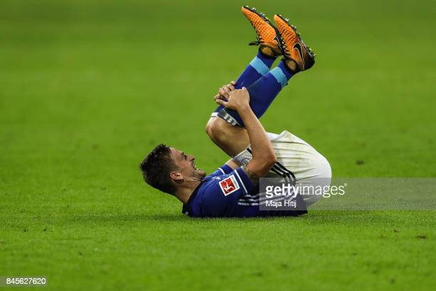 Bastian Oczipka of Schalke reacts during the Bundesliga match between FC Schalke 04 and VfB Stuttgart at VeltinsArena on September 10 2017 in...