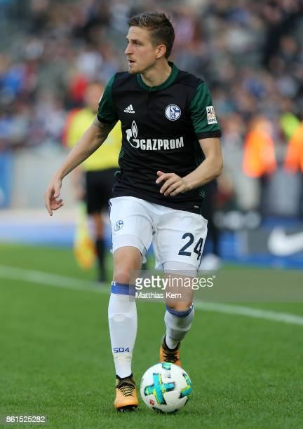 Bastian Oczipka of Schalke runs with the ball during the Bundesliga match between Hertha BSC and FC Schalke 04 at Olympiastadion on October 14 2017...