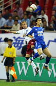 Bastian Reinhardt of Germany's Hamburg HSV fights for the ball with Sun Ji of China's Shanghai Shenhua during the friendly match between Germany`s...