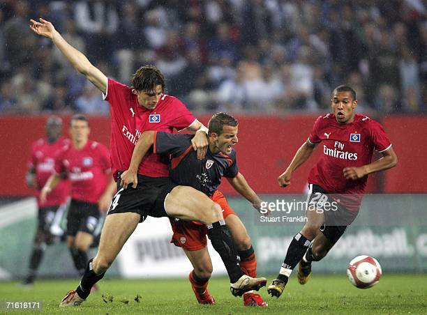 Bastian Reinhardt of Hamburg challenges Roberto Soldado Rillo of Osasuna during the UEFA Champions League qualification round third round match...