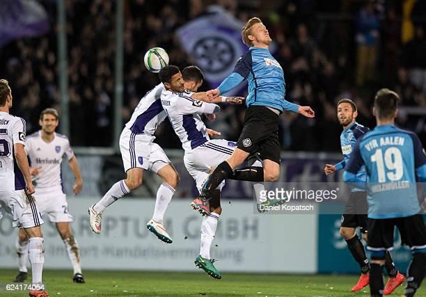 Bastian Schulz of Osnabrueck Marcel Appiah of Osnabrueck and Gerrit Wegkamp of Aalen jump for a header during the third league match between VfR...