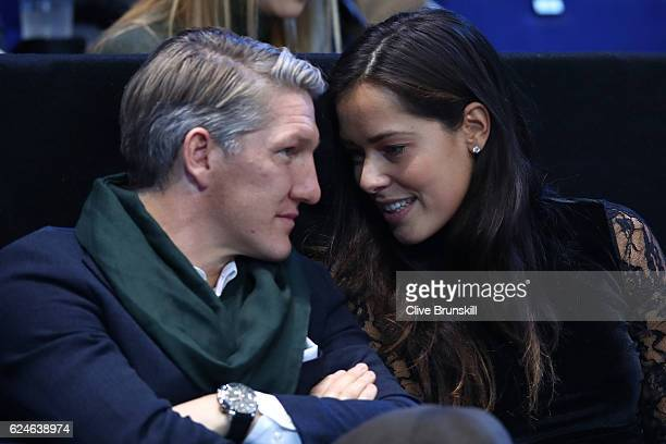 Bastian Schweinsteiger and Ana Ivanovic attend the Singles Final between Novak Djokovic of Serbia and Andy Murray of Great Britain at the O2 Arena on...