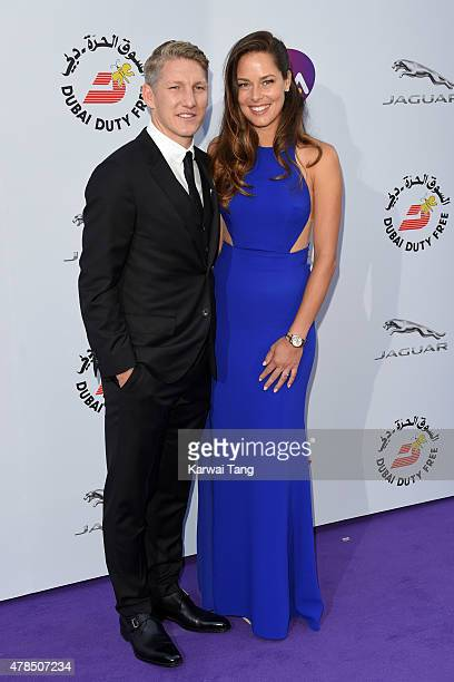 Bastian Schweinsteiger and Ana Ivanovic attend the WTA PreWimbledon Party at Kensington Roof Gardens on June 25 2015 in London England