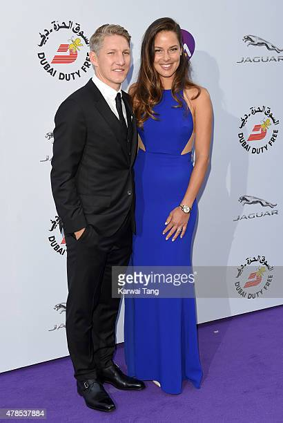 Bastian Schweinsteiger and Ana Ivanovic attend the WTA PreWimbledon Party at Kensington Roof Gardens on June 25 2015 in London England