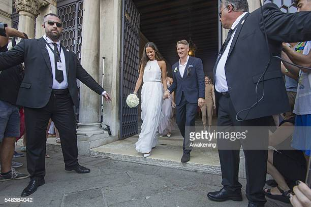 Bastian Schweinsteiger and Ana Ivanovic come out of the wedding hall at Palazzo Cavalli after the celebration of their marriage on July 12 2016 in...