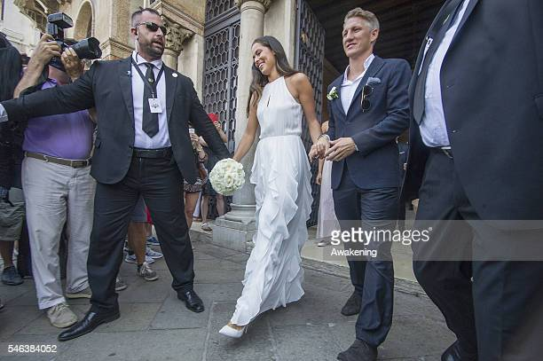 Bastian Schweinsteiger and Ana Ivanovic comes out of the wedding hall at Palazzo Cavalli after the celebration of their marriage on July 12 2016 in...