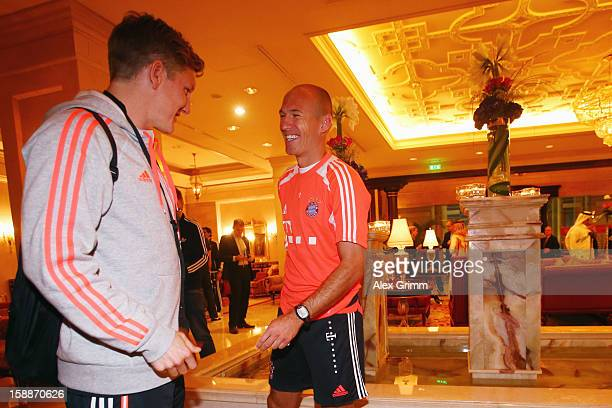 Bastian Schweinsteiger and Arjen Robben arrive at the Grand Heritage Hotel on day 1 of the Bayern Muenchen training camp on January 2 2013 in Doha...