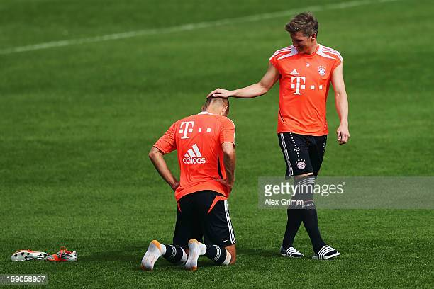 Bastian Schweinsteiger and Arjen Robben attend a Bayern Muenchen training session at the ASPIRE Academy for Sports Excellence on January 7 2013 in...