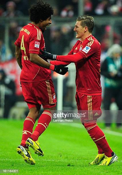 Bastian Schweinsteiger and Dante of Muenchen celebrate a goal during the Bundesliga match between FC Bayern Muenchen and FC Schalke 04 at Allianz...