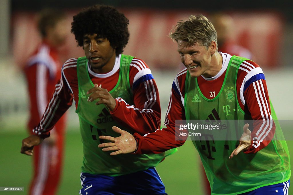 <a gi-track='captionPersonalityLinkClicked' href=/galleries/search?phrase=Bastian+Schweinsteiger&family=editorial&specificpeople=203122 ng-click='$event.stopPropagation()'>Bastian Schweinsteiger</a> (R) and Dante react during day 3 of the Bayern Muenchen training camp at ASPIRE Academy for Sports Excellence on January 11, 2015 in Doha, Qatar.