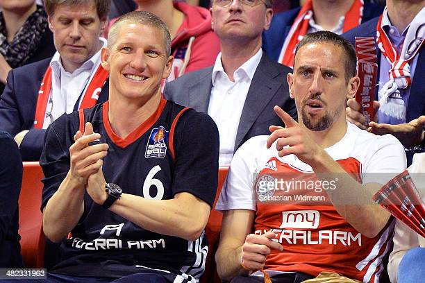 Bastian Schweinsteiger and Frank Ribery attend the 20132014 Turkish Airlines Euroleague Top 16 Date 13 game between FC Bayern Munich v Maccabi...
