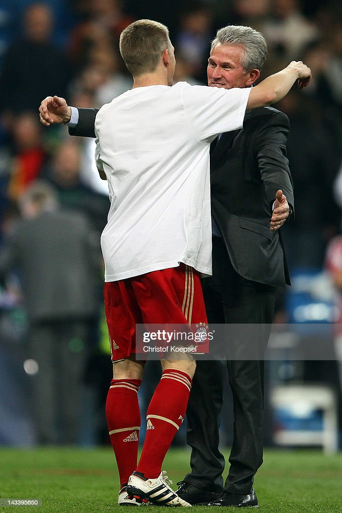 <a gi-track='captionPersonalityLinkClicked' href=/galleries/search?phrase=Bastian+Schweinsteiger&family=editorial&specificpeople=203122 ng-click='$event.stopPropagation()'>Bastian Schweinsteiger</a> and Head coach <a gi-track='captionPersonalityLinkClicked' href=/galleries/search?phrase=Jupp+Heynckes&family=editorial&specificpeople=2062040 ng-click='$event.stopPropagation()'>Jupp Heynckes</a> of Bayern celebrate the 3-1 victory after penalty shoot-out after the UEFA Champions League semi final second leg match between Real Madrid and Bayern Muenchen at Bernabeu Stadium on April 25, 2012 in Madrid, Spain.