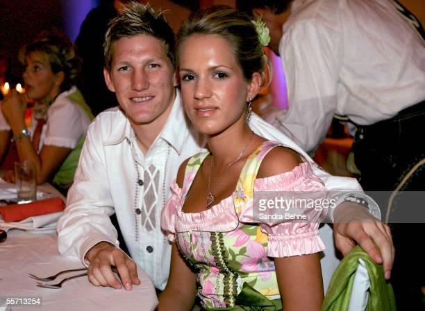 Bastian Schweinsteiger and his girlfriend Daniela Aumeier pose at the Arabella Sheraton Hotel on September 17 2005 in Munich Germany German...