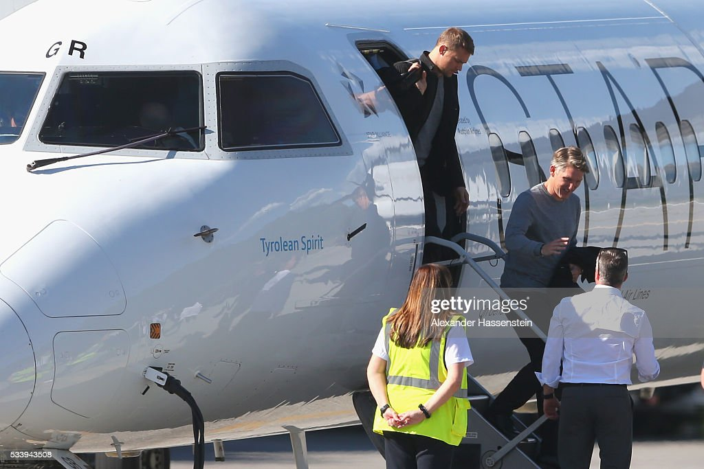 <a gi-track='captionPersonalityLinkClicked' href=/galleries/search?phrase=Bastian+Schweinsteiger&family=editorial&specificpeople=203122 ng-click='$event.stopPropagation()'>Bastian Schweinsteiger</a> (R) and his team mate <a gi-track='captionPersonalityLinkClicked' href=/galleries/search?phrase=Manuel+Neuer&family=editorial&specificpeople=764621 ng-click='$event.stopPropagation()'>Manuel Neuer</a> (L) of Germany arrives with the German national team at Lugano Airport on May 24, 2016 in Ascona, Switzerland.