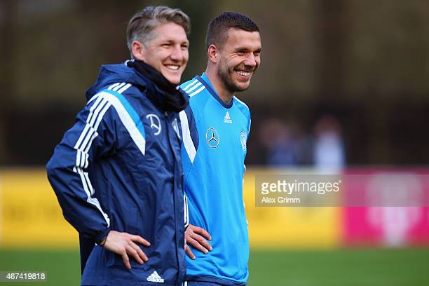 Bastian Schweinsteiger and Lukas Podolski attend a Germany training session at Kleine Kampfbahn training ground on March 24 2015 in Frankfurt am Main...